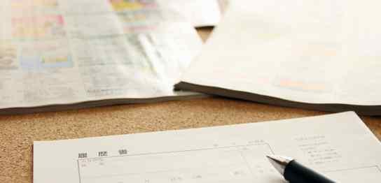 履歴書とペン